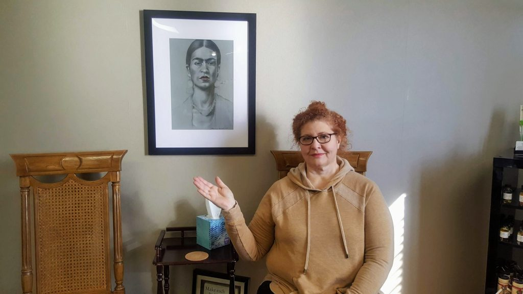 """Deb Francisco-Ferrell showing her Pastel on Tinted Paper art of Frida Kahlo. The art piece is titled """"Frida""""."""
