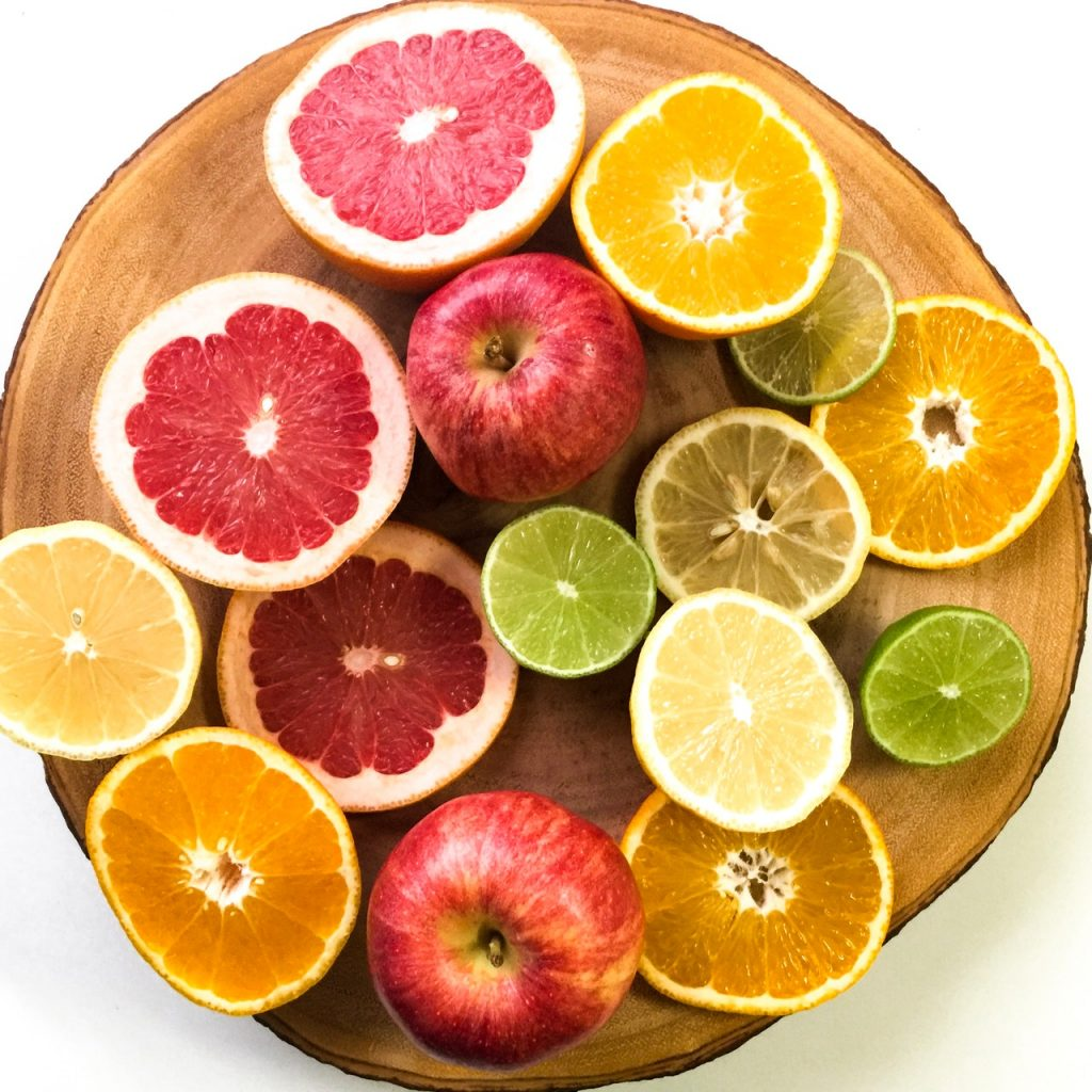A Plate of chopped Apples, Limes, Lemons, Oranges, and Grapefruit