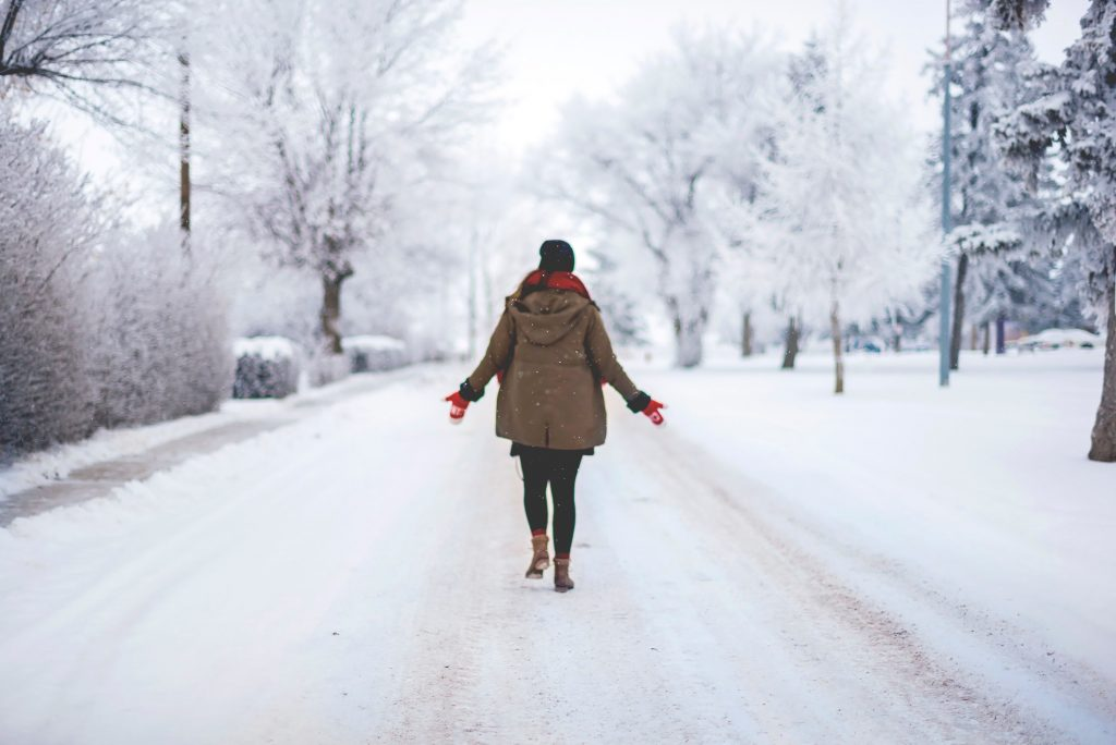 Person walking on a snow covered street