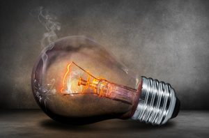 A cracked light bulb fading showing the need for help with new ideas